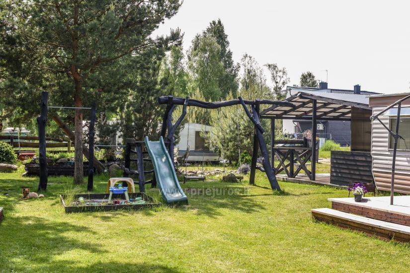 Wakacje w Połądze - drewniane domki, pole namiotowe, namioty (Od 5 € / osoby dla grup) - 42