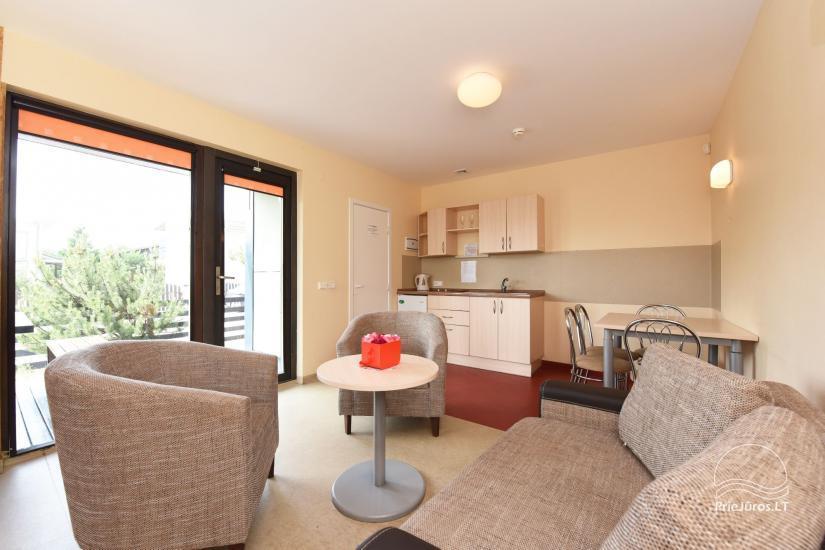 Kompleks rekreacyjny: domki letniskowe, apartamenty, pokoje do wynajęcia blisko morza - 1