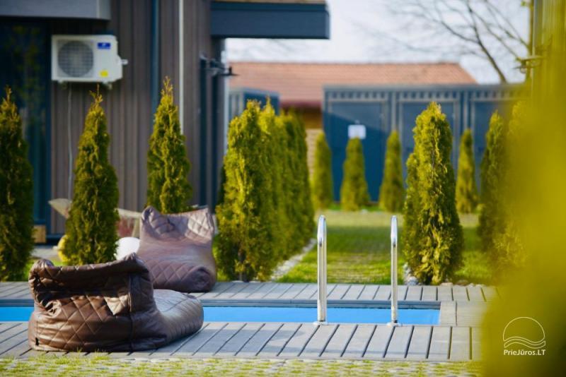 Nowe mieszkanie z podgrzewanym odkrytym basenem do wynajęcia w Kunigiskiai
