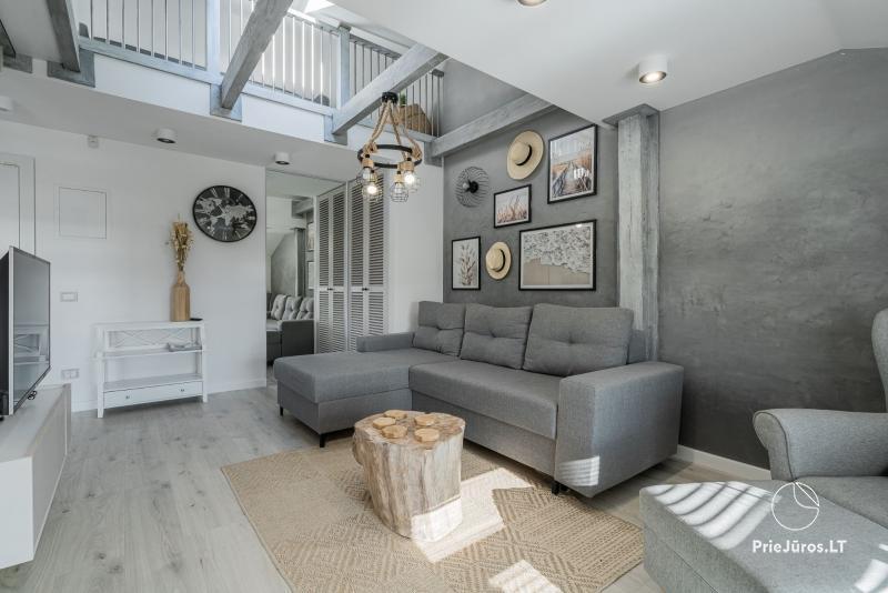 Apartamenty w NidzieCome'In Nidaz widokiem na Zalew Kuroński