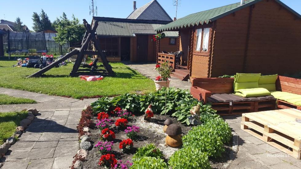 Drewniane domki lentniskowy nad morzem w Sventoji - 6