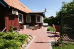 2 pokojowe mieszkanie w centrum Nidy z prywatnym ogrodem