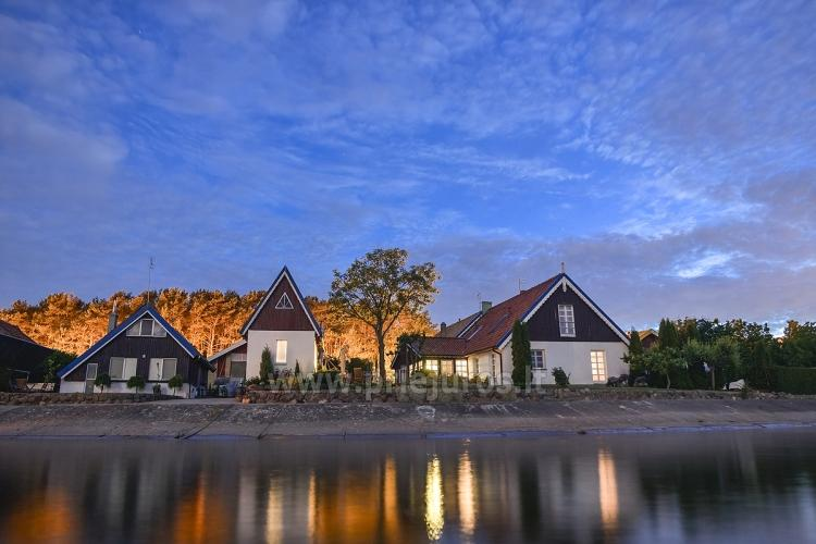 cOddzielne domki letniskowe i apartamenty na brzegu laguny - 1
