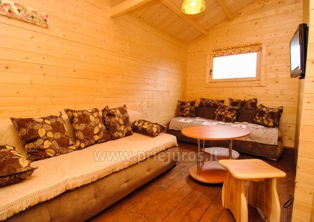 Nowe, przytulne domki i pensjonat w centrum Sventoji - 9