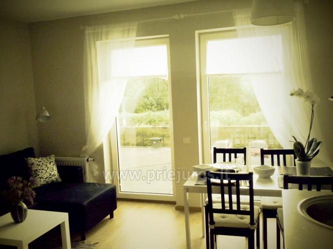 Mieszkanie w stylu skandynawskim: plac zabaw dla dzieci, widok słońca - 7