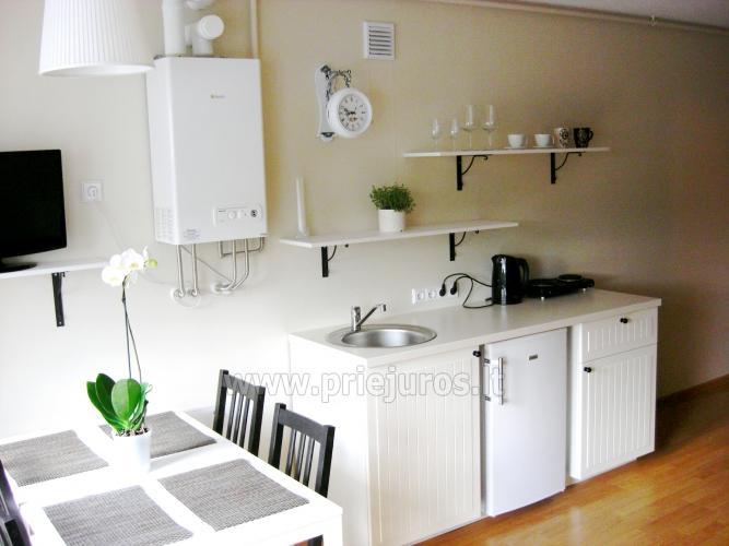 Mieszkanie w stylu skandynawskim: plac zabaw dla dzieci, widok słońca - 9