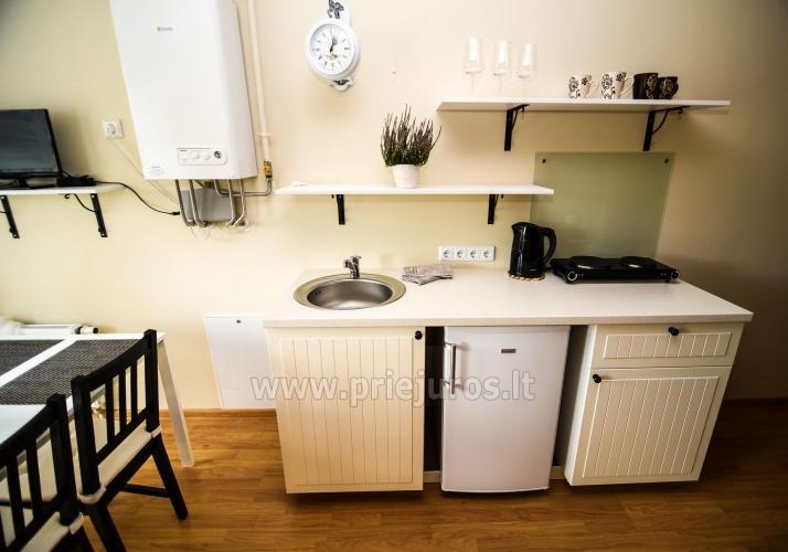 Mieszkanie w stylu skandynawskim: plac zabaw dla dzieci, widok słońca - 8