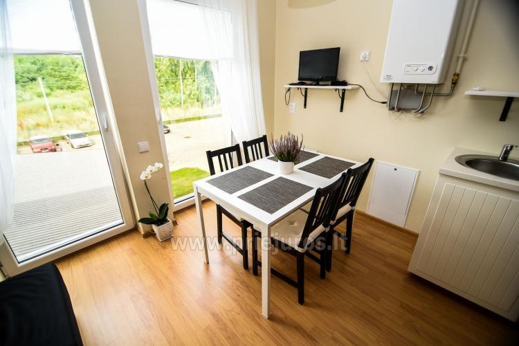 Mieszkanie w stylu skandynawskim: plac zabaw dla dzieci, widok słońca - 2