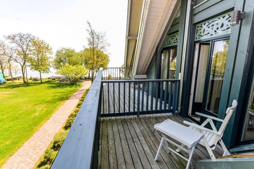 Apartament w Preila na brzegu Mierzei Kurońskiej, balkon z widokiem na lagunę - 8