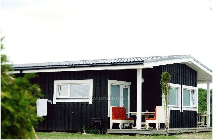 Nowe jednopokojowe, dwupokojowe drewniane domy w Sventoji - 1