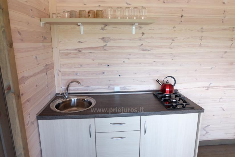 Nowe jednopokojowe, dwupokojowe drewniane domy w Sventoji - 4