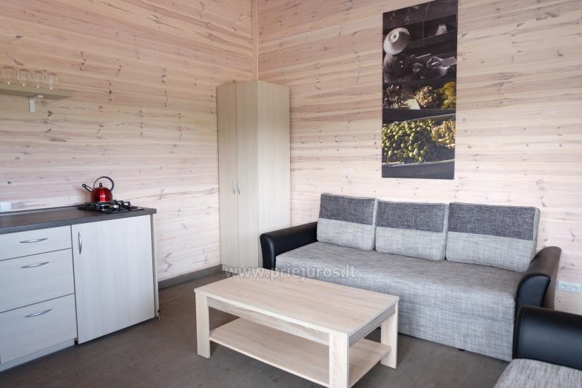 Nowe jednopokojowe, dwupokojowe drewniane domy w Sventoji - 5