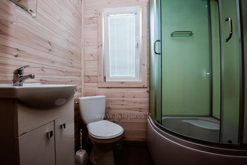 Nowe jednopokojowe, dwupokojowe drewniane domy w Sventoji - 7