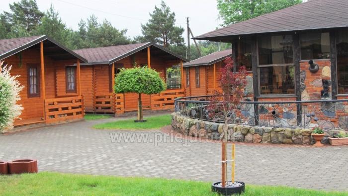Dziugutis. Countryside Farmstead with Bathhouse in Sventoji